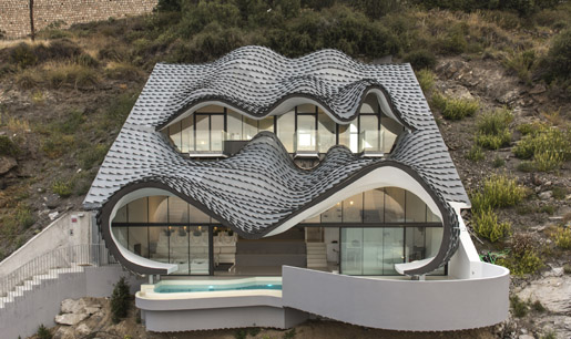 Zinc Shingles on a unique Cliff House in Salobrena