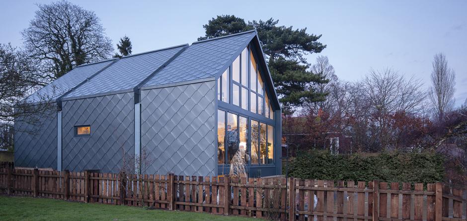 Zinc shingles on the amphibious house for Modern zinc houses