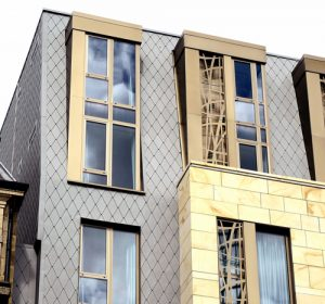 VITA Student Newcastle: Contemporary Zinc Shingles and Stone Cladding