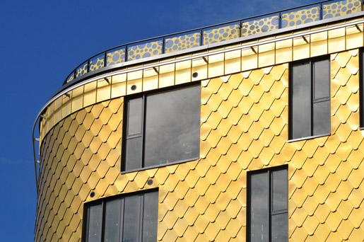 The Fold, Sidcup. Fish scale shingles in KME TECU Gold Copper Alloy Shingles