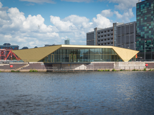 The Alchemist, Salford Quays – Cladding a gold folded box