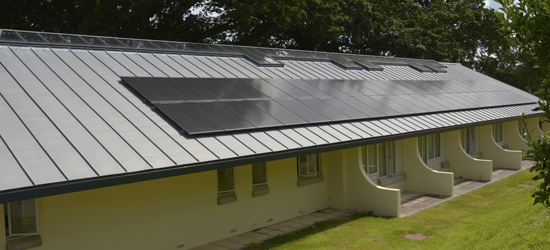 Replacement zinc standing seam roof with solar PVs